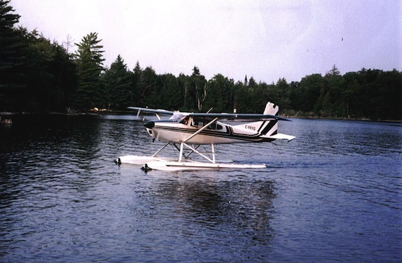 Small white plane floating on a lake